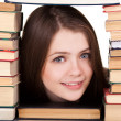 Stock Photo: Teen girl with lot of books around, isolated on white