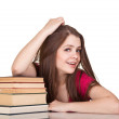 Teen girl with lot of books, isolated on white — Stock Photo