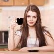 Stock Photo: Beautiful happy young woman drinking coffee at home