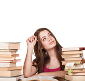 Teen girl learning at the desk, with lot of books around, isolat — Stock Photo
