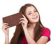 Shot of a beautiful teen girl holding big chocolate bar — Stock Photo