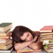 Sleeping while learning - tired teen woman sleeping on desk - Stock Photo