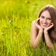 Beautiful young blonde woman on the meadow on a warm summer day — Stock Photo #5870960