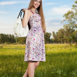 Stylish woman in dress with bag outdoor. Summer shopping time — Stock Photo
