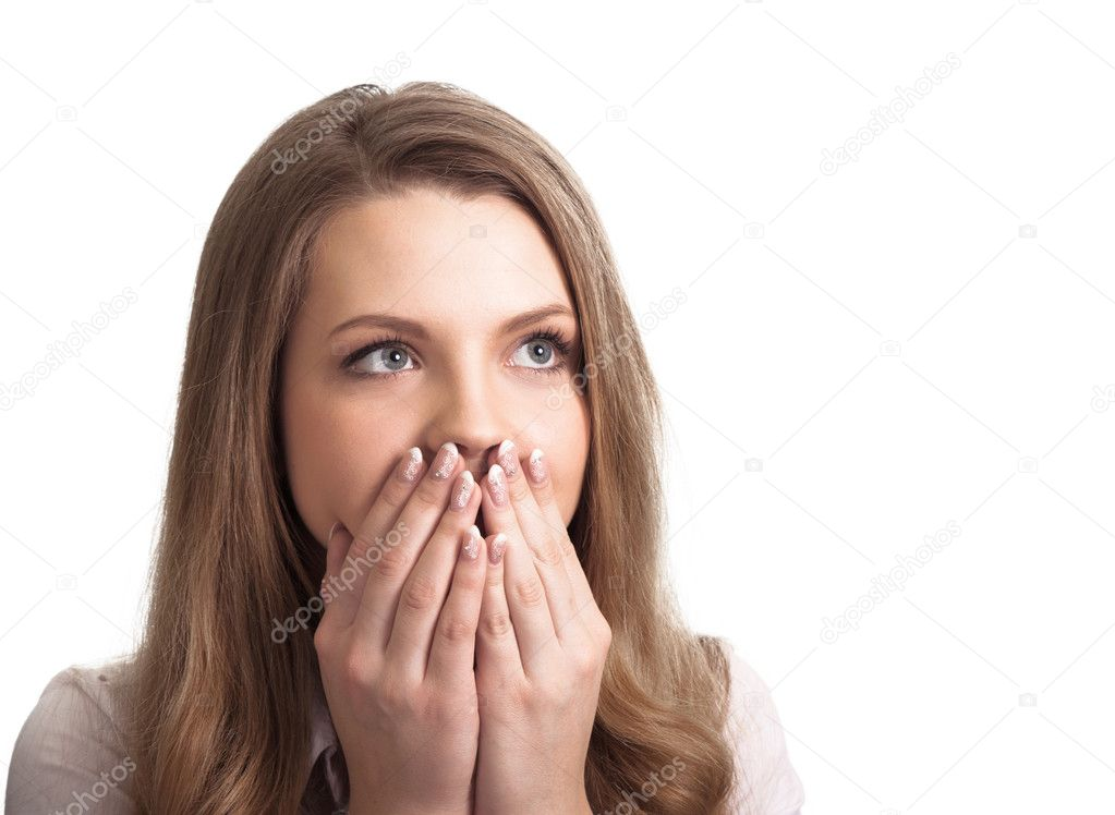 Portrait of a surprised young woman with hands over her mouth laughing against white background  — Stock Photo #5870923