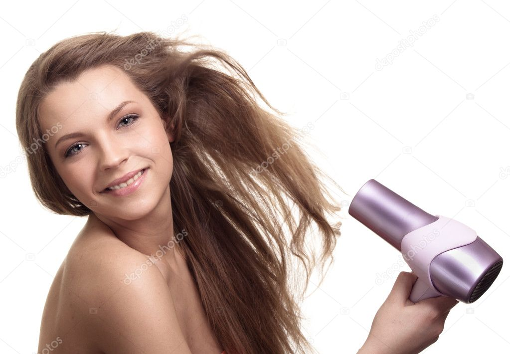 Beautiful woman drying her hair with hairdryer   Stock Photo #5905631