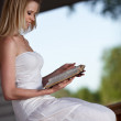 Attractive smiling woman relax with book — Stock Photo #5916932
