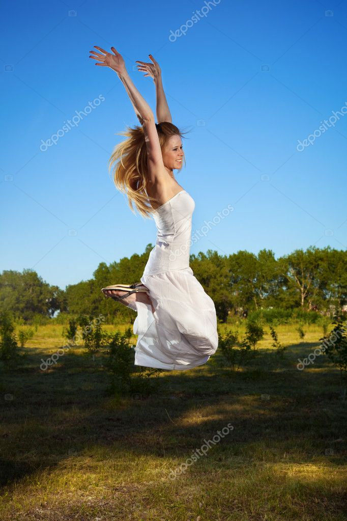 Happy young woman jumping outdoor — Stock Photo #5916928