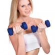 Portrait of a happy sporty woman with a dumbbell on white backgr — Stock Photo