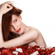 Beautiful woman and rose petals on white background — Stock Photo #5960774