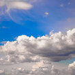 Blue sky background with clouds - Foto Stock