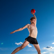 Male beach volleyball game player jump in blue sky — Stock Photo