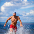 Man run on the sea — Stock Photo