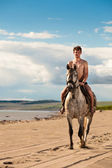 Horseman on the beach — Stock Photo