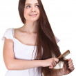 Portrait of a beautiful youth teen girl with comb isolated — Stock Photo