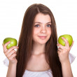 Stock Photo: Young happy smiling teen girl with green apple isolated on white