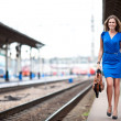 Stock Photo: Attractive lady waiting train on the platform of railway station