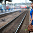 Attractive lady waiting train on the platform of railway station — Photo