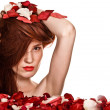 Beautiful woman and rose petals on white background — Stock Photo