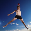 Royalty-Free Stock Photo: Male beach volleyball game player jump in blue sky