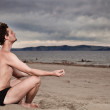 Man in the meditation on the shore of the sea — Stock Photo