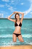 Happy woman on beach — Stock Photo