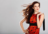 Beautiful sexy caucasian woman in stylish dress. Studio shot — Stockfoto
