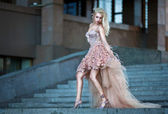 Blond beautiful woman in luxury wedding dress — Stock Photo