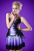 Beautiful luxurious woman on purple background — Fotografia Stock