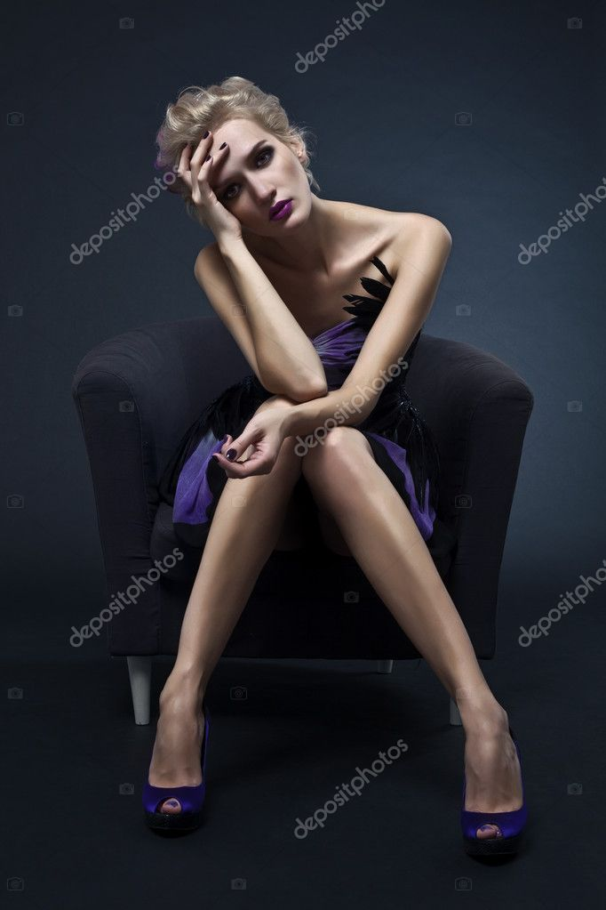 The image of a beautiful luxurious woman sitting on chair. Studio shot — Stock Photo #6658758
