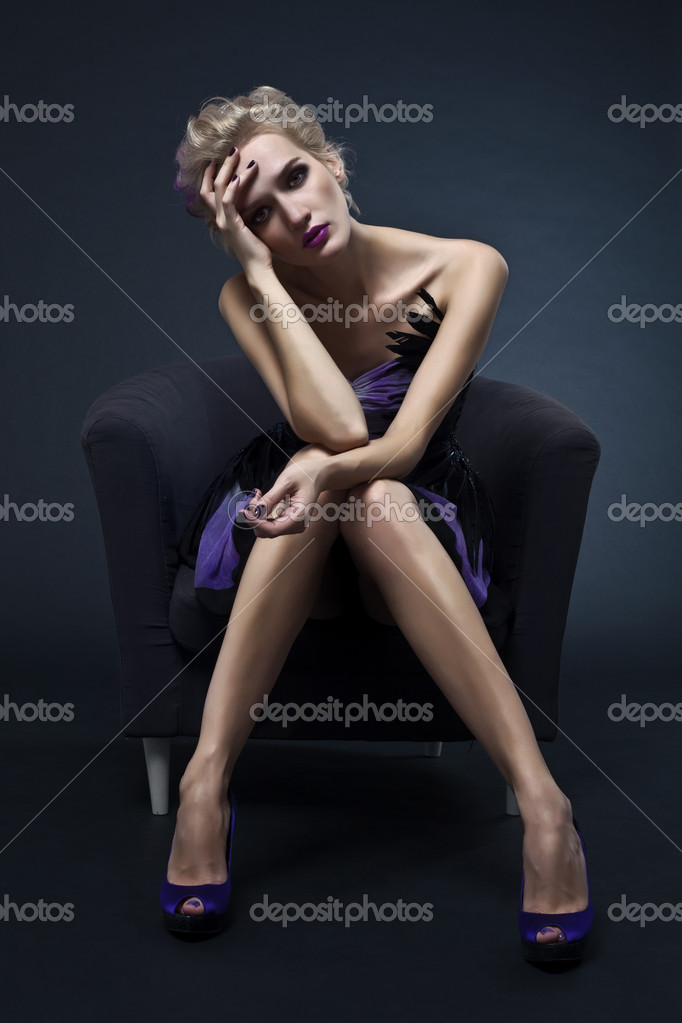 The image of a beautiful luxurious woman sitting on chair. Studio shot  Stok fotoraf #6658758