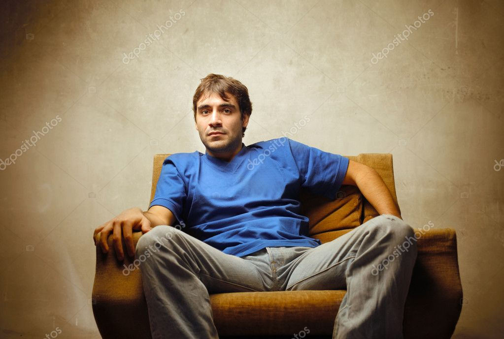 Young man relaxing on an armchair — Stock Photo #5752677
