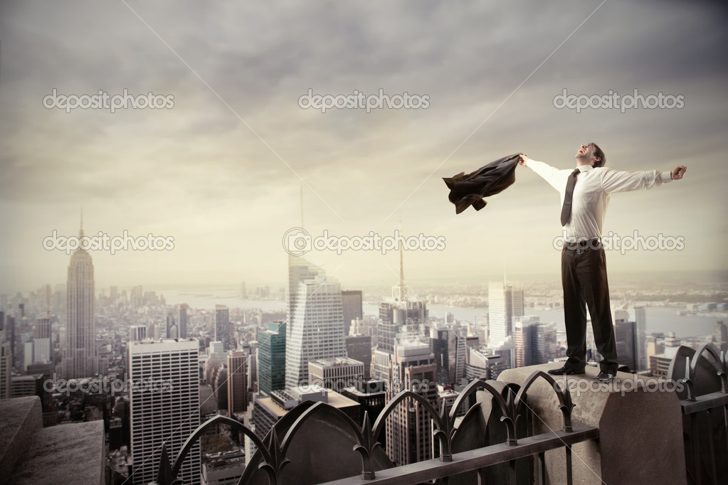 Happy businessman standing on the rooftop of a skyscraper  Foto Stock #5752685