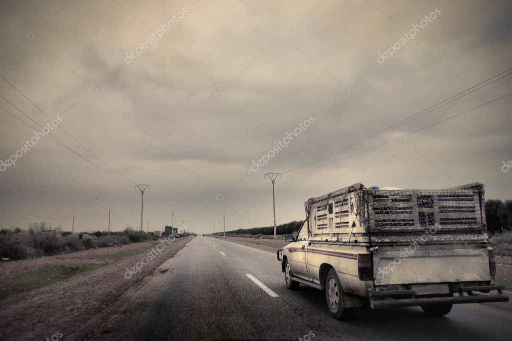 Pick-up on a countryside road — Stock Photo #5757584