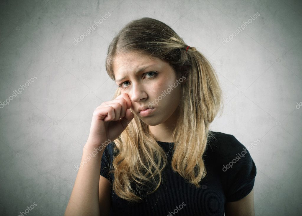 Portrait of a sad young woman crying — Stock Photo #5759446