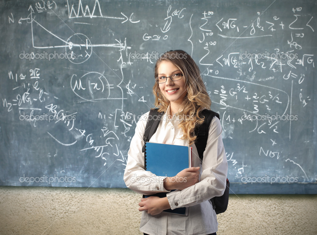 Smiling beautiful student in a classroom — Stock Photo #5762838