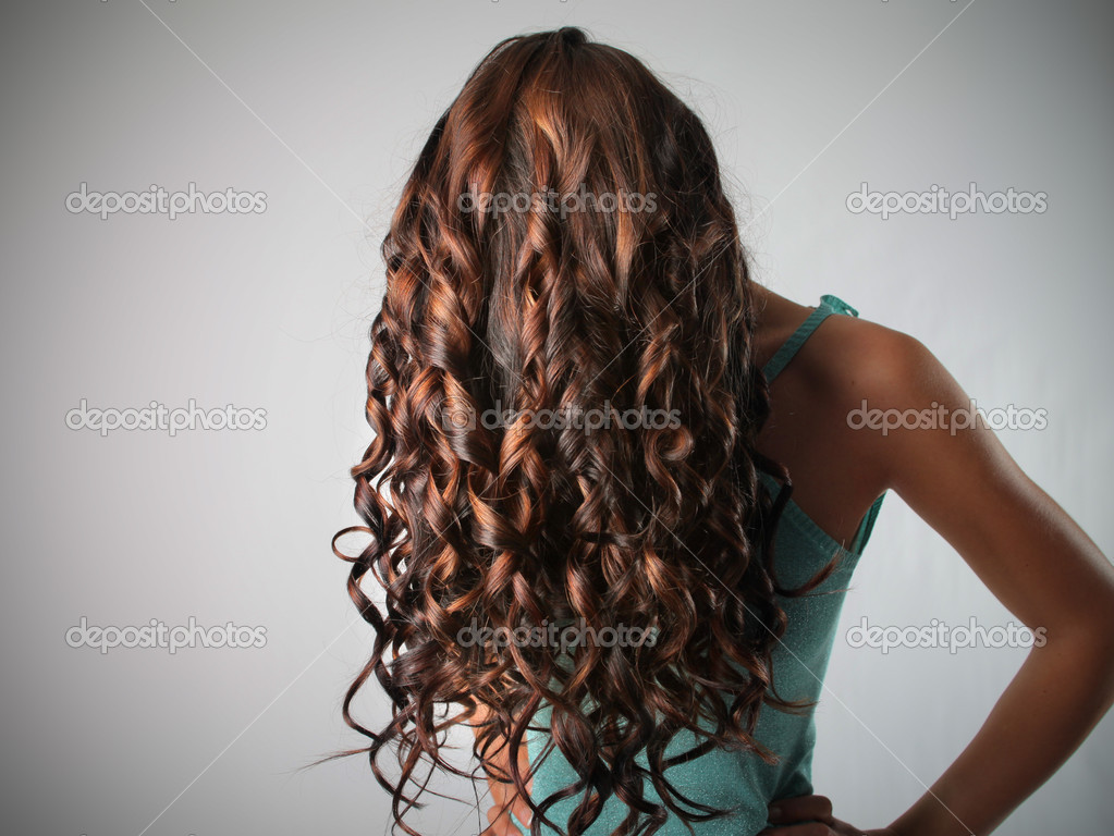 Beautiful woman with curly hair — Stock Photo #5948522