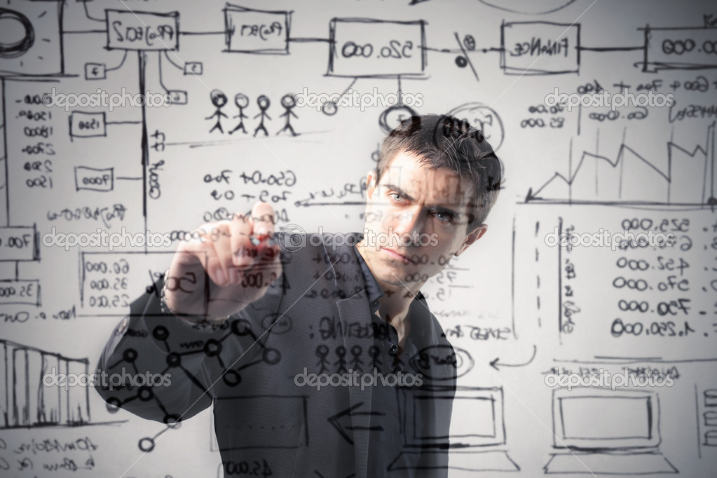 Young businessman drawing a strategy scheme — Stock Photo #5948666
