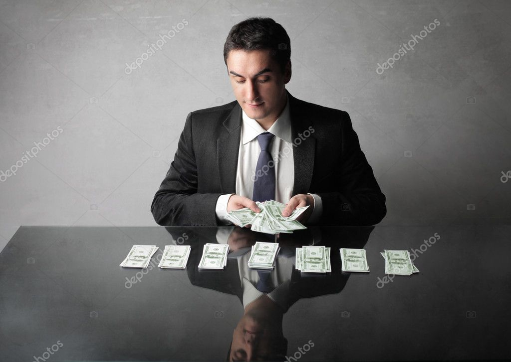 Businessman counting out some banknotes — Stock Photo #5949578