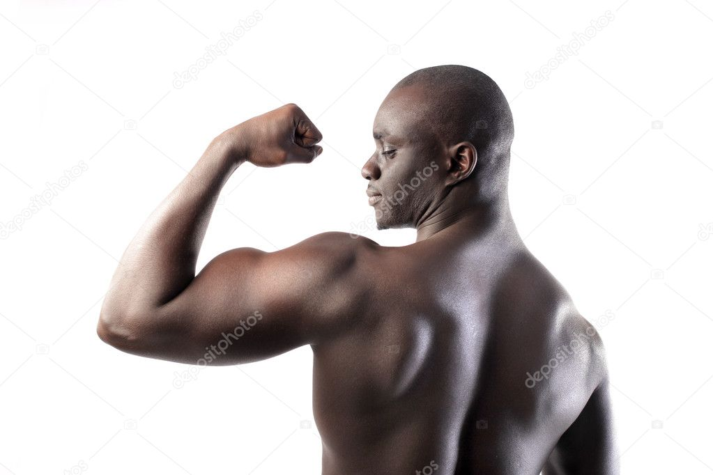 Handsome african man showing his biceps — Stock Photo #5952196