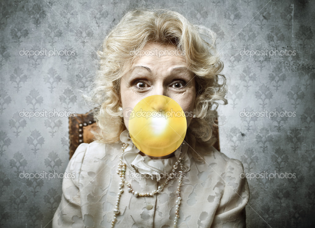 Senior woman blowing a bubblegum  Stock Photo #6309201