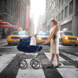 Mother in the city — Stock Photo