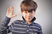 Child with his right hand raised — Stock Photo