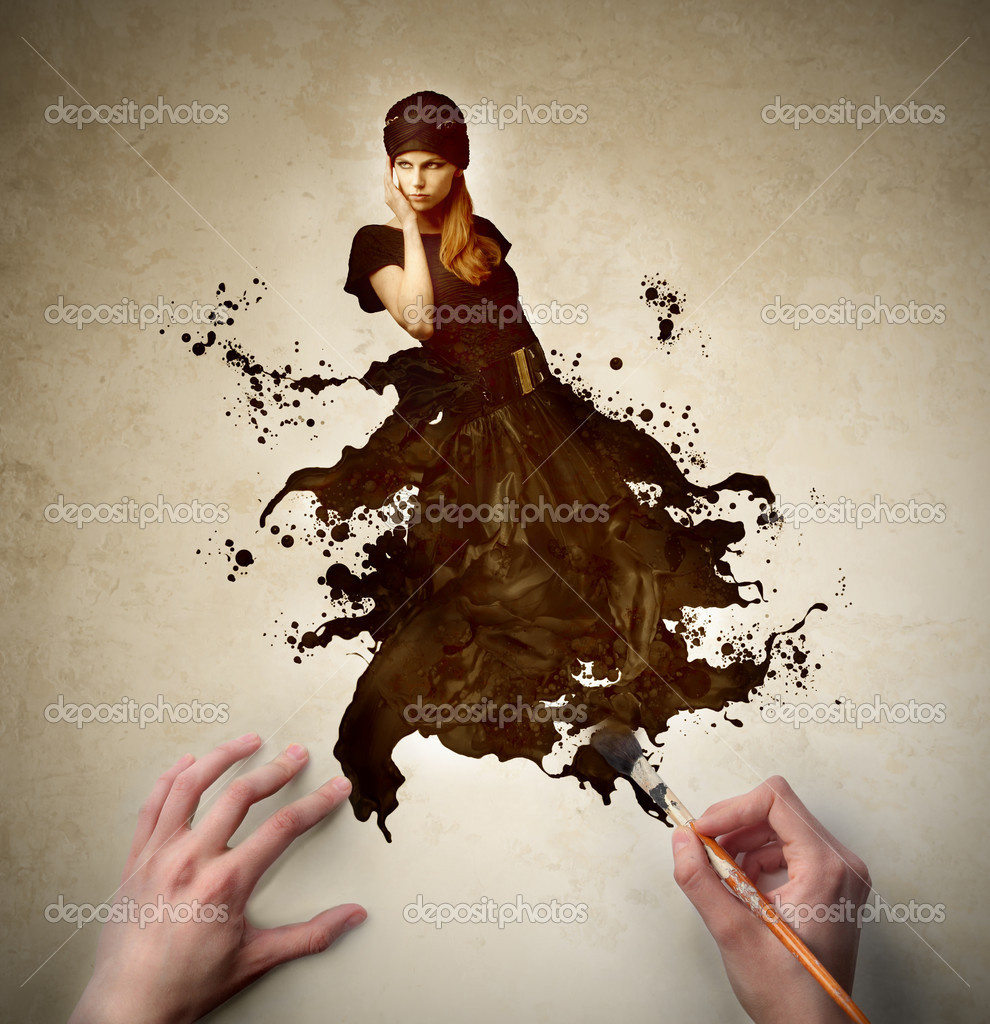Man's hands painting the dress of a beautiful woman — Stock Photo #6313354