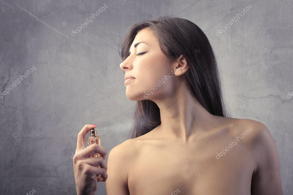 Beautiful woman spraying perfume on her neck — Stock Photo #6313374