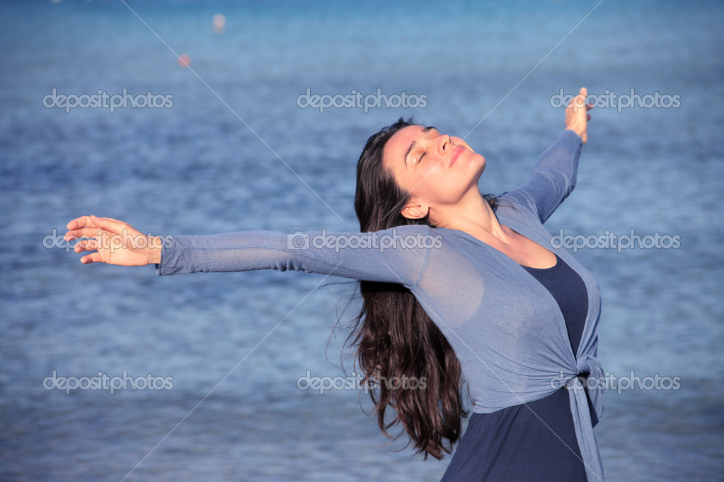 Smiling woman stretching at the seaside — Stock Photo #6317134