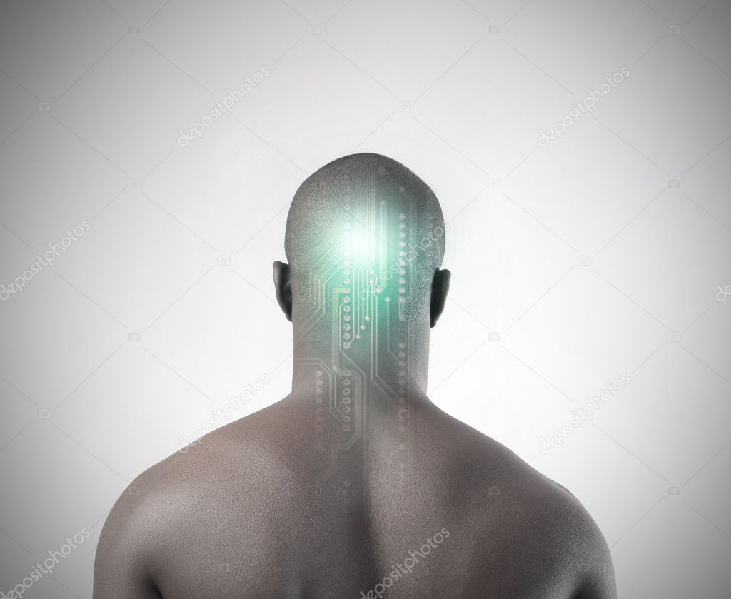 Rear view of an african man with a microchip in his head  Stock Photo #6321141