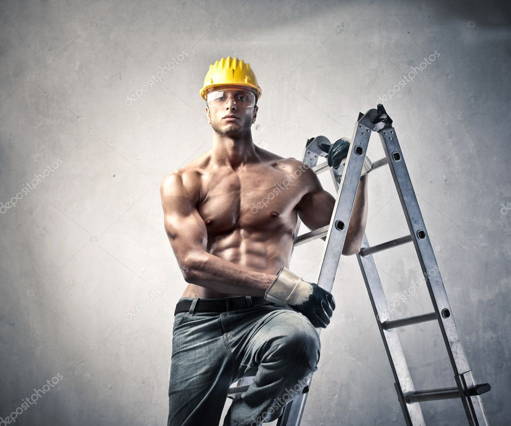 Handsome worker on a ladder  Stock Photo #6323593