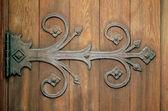 Ornamental Iron Hinge On An Old Wooden Door — Stock Photo