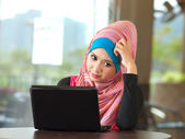 Young muslim women using laptop — Stock Photo